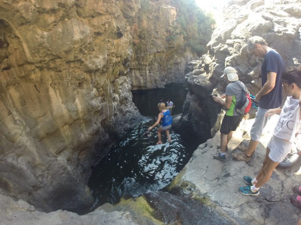 Rappelling on the Golan - Black Ravine - Jumping the first pool