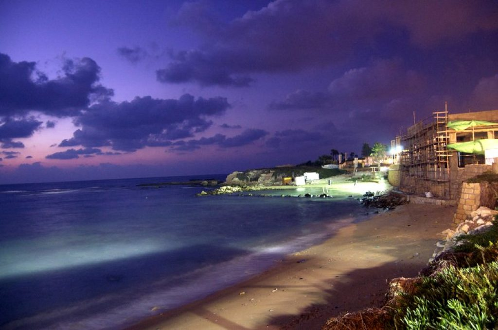 the ancient port city of caesarea at night